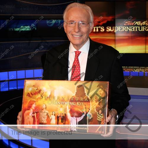 Sid Roth holding the Supernatural Mentoring Kit