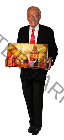 Sid Roth proudly showing the Mentoring package